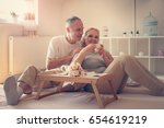 senior couple in bed. senior... | Shutterstock . vector #654619219