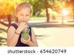 happy girl drinks ice cold... | Shutterstock . vector #654620749