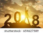 man hand up on the peak of... | Shutterstock . vector #654627589