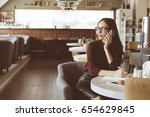 woman at the cafeteria speak on ... | Shutterstock . vector #654629845