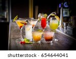 Stock photo cocktail glass on the wood table 654644041