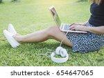 Asian Woman Sitting On Green...