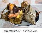 rice dumpling  zongzi or... | Shutterstock . vector #654661981