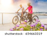 couple with an ebike in holidays | Shutterstock . vector #654663319
