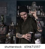 Stock photo flair smiling bartender in action 654671557