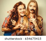 two stylish sexy hipster girls... | Shutterstock . vector #654675415