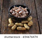 boiled peanuts on wood | Shutterstock . vector #654676474