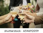 cheerful guests at the wedding | Shutterstock . vector #654692059
