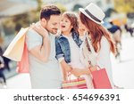 happy family with shopping bags ... | Shutterstock . vector #654696391