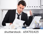 businessman feeling thirsty and ... | Shutterstock . vector #654701425