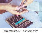business woman hand... | Shutterstock . vector #654701599