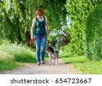 mature woman walking with... | Shutterstock . vector #654723667