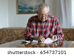 thoughtful handsome senior man... | Shutterstock . vector #654737101