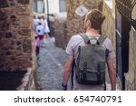 man traveler with backpack... | Shutterstock . vector #654740791