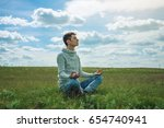 man traveler with backpack sits ... | Shutterstock . vector #654740941