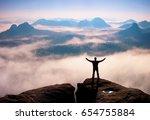 gesture of triumph. happy hiker ... | Shutterstock . vector #654755884