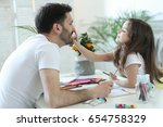 family. father with daughter at ... | Shutterstock . vector #654758329