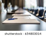 close up of dark conference... | Shutterstock . vector #654803014
