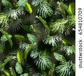 tropical leaves pattern. green... | Shutterstock . vector #654810709