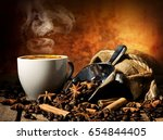 tasty hot coffee with grains... | Shutterstock . vector #654844405