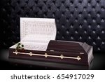 Stock photo opened wooden brown sarcophagus with a red roses isolated on gray luxury background casket coffin 654917029