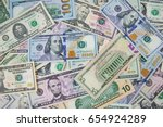 Stock photo  money american hundred dollar bills pile of various currencies isolated on white background 654924289