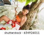 woman in bikini relaxing under...   Shutterstock . vector #654926011