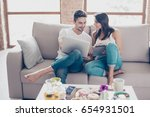 cheerful happy couple is doing... | Shutterstock . vector #654931501