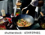 food being prepared on a stove  | Shutterstock . vector #654939481