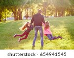 father plays with daughters. | Shutterstock . vector #654941545