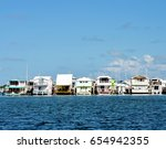 A Row Of Colorful Houseboats...