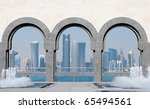 Stock photo doha skyline seen through the arches at the museum of islamic art doha qatar 65494561