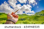Small photo of Cannabis in a Blunt with Clouds