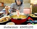 asian woman enjoy eating meat   ... | Shutterstock . vector #654951295
