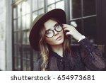 outdoor close up portrait of... | Shutterstock . vector #654973681