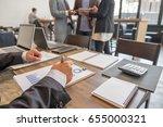 businessmen working in a room... | Shutterstock . vector #655000321