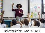 kindergarten students sitting... | Shutterstock . vector #655001611