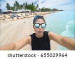 asian girl in sunglasses taking ... | Shutterstock . vector #655029964