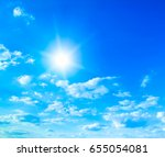 blue sky with clouds and sun. | Shutterstock . vector #655054081