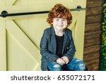 smiling little boy in ripped... | Shutterstock . vector #655072171