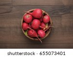 fresh red radishes in wooden... | Shutterstock . vector #655073401