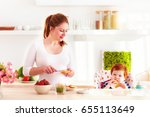 happy young mother and infant... | Shutterstock . vector #655113649