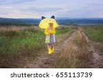 on a rainy  cloudy day  a girl...   Shutterstock . vector #655113739