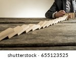businessman wearing suit... | Shutterstock . vector #655123525