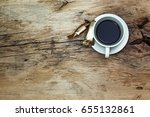 cup of coffee on wooden table ... | Shutterstock . vector #655132861