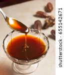 sweet and delicious date syrup... | Shutterstock . vector #655142671