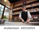 woman cutting knead in... | Shutterstock . vector #655152931