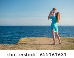 mom and child on beach  holiday ... | Shutterstock . vector #655161631