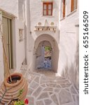 Small photo of Greece, picturesque alley in a Aegean island