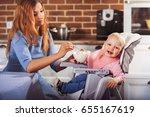 little baby girl sits in high... | Shutterstock . vector #655167619
